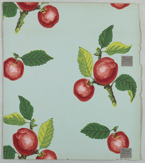 Design of red apples on branch sprigs. Printed on light green ground.