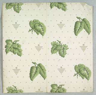Two different pairs of leaves alternate, printed on dotted ground. Between each of the leaf motifs is a triangle pointed down with a dot on top center. Printed in green and gray on off-white gound.
