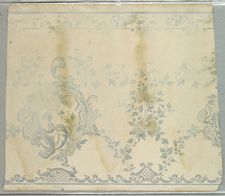Rococo scrolls alternate with festooned sprays of roses. At top of frieze is a small band of scrolls. At the bottom is another band of roses. Portions of design are in ice-blue powdered mica. The field is old ivory. Printed in blue on ivory.