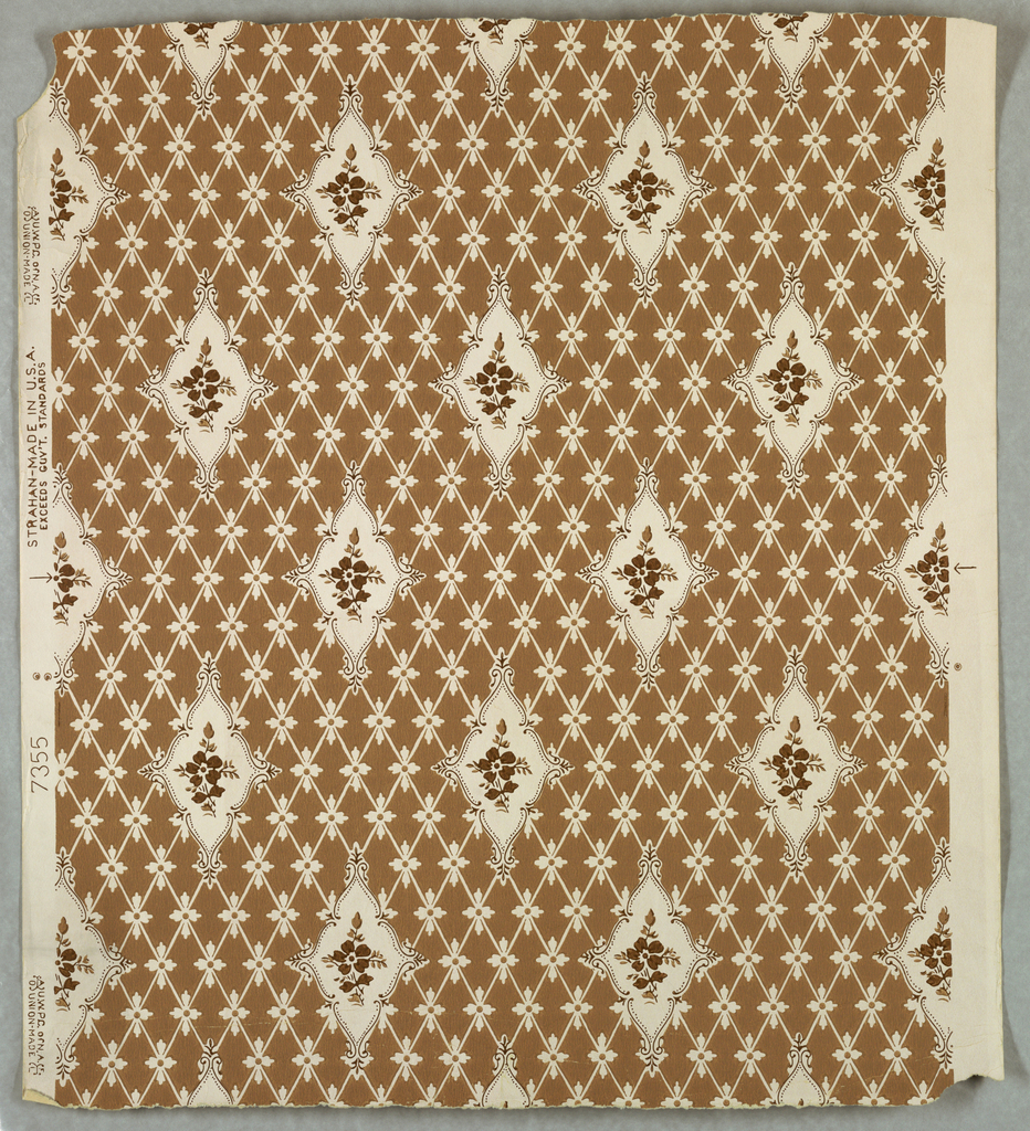 """Drop-repeating medallions with scroll frames centered with a daisy and sprigs. The ground has a diamond diaper with florets at the conjunction of the diagonal lines. Printed on white ground with brown """"choke""""."""