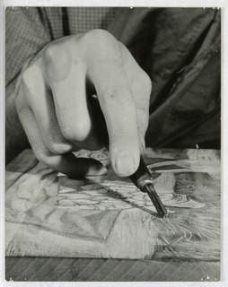 Photograph showing the process of making a woodcut.  Related woodblock, print, and tools used by Will Barnet part of same gift.