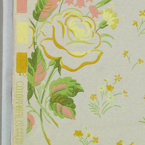 Bouquets of roses, carnations, and lilies-of-the-valley arranged as drop repeats with small flowers and leaves filling the spaces between. Printed in several shades of yellow, green, and pink on gray ground.