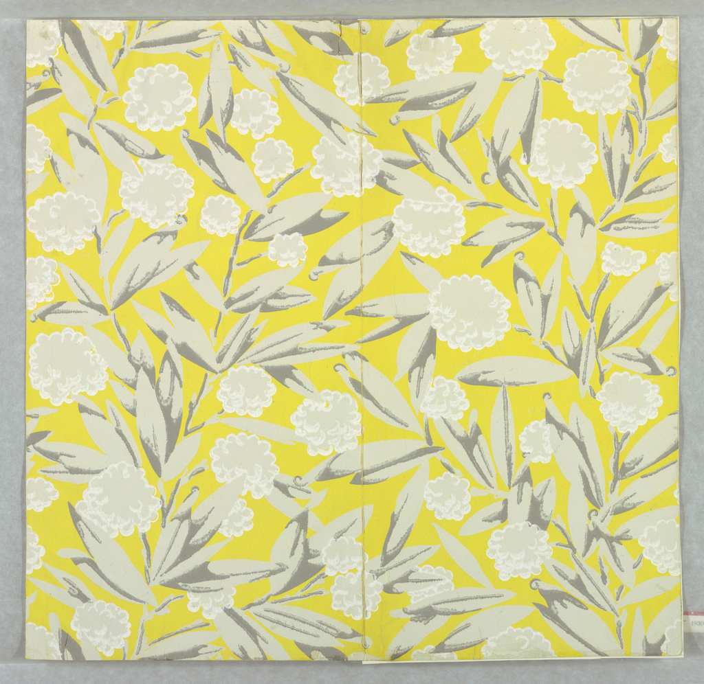 A branching shrub with elongated pointed leaves and cotton boll-like flowers.  Printed in two shades of gray and white on a chartreuse ground.