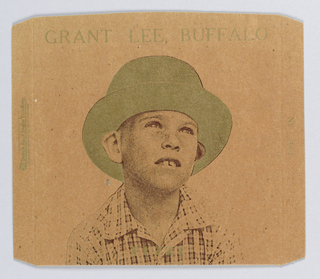 Record sleeve of cardboard with image of a boy with a plaid shirt, and a gold hat.