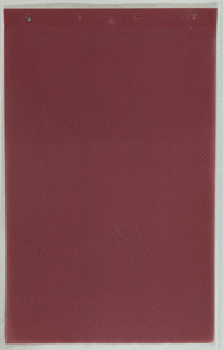 Burgundy paper embossed with pebble texture