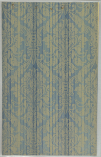 Art Deco sidewall with Neo-Renaissance vertically-symmetrical pattern of stylized yellow foliage reminiscent of those found on brocades; second pattern of dark blue stripes printed on top; the ground under the foliage in between each stripe is a different shade of blue; uneven coloring reminiscent of various levels of fading.