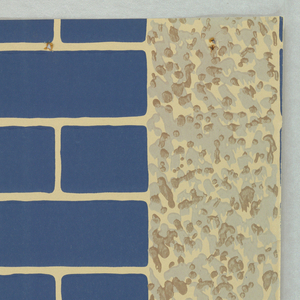 Alternating stripes of blue bricks and off-white faux-stucco.