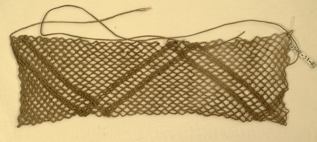 Netted panel with a pattern of parallel zigzag lines, with two strings attched.