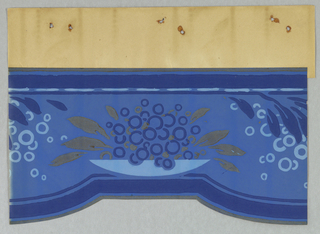 Cut-out border with scalloped bottom edge, containing central motif of a stylized bowl filled with small circles possibly representing fruit or grapes, metallic gold foliage on outskirts. This is centered between chusters of foliage suspended from top edge, interspersed with more circles. Printed in shades of blue and metallic gold on blue ground.