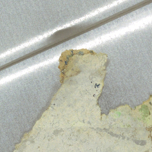Four very small fragments. There is very little pigment remaining on any of these pieces. -b) has the appearance of a gray imitation stone design