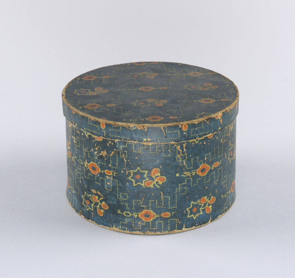 Workbox for seamstress, covered with simple geometric small-scale floral pattern, cloth pocket inside.