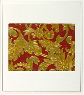 Scrolling vines with flowers. Embossed areas printed in gold against a textured red background.
