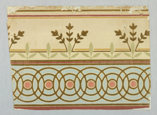 "Border; upper half consists of series of interwined gilt circles forming a geometric pattern. In center of each is a coral colored disc in light blue field. Lower portion consists of stylized stiff sprays, three stems each ofgilt leaves under a series of three petalled formal gray-olive leaf motifs all on a bisque field. Deep coral, gold and gilt lines top, botton and in center of border. ""No. 1639, Robert Graves Co."" printed in selvedge."