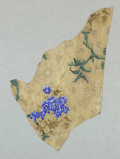 Irregularly-shaped portion of design showing vine and floral cluster; ground decorated with foliate shapes formed of small dots. Printed in greens, blues and browns.