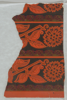 Small fragment displaying two and one half bands set with conventional chrysanthemum flower, and foliage clusters. Printed in black, red and gold on orange ground.