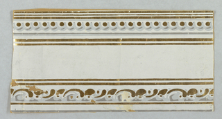 Horizontal rectangle. Architectural molding, upper edge with scrolls, lower edge with arcs set with gold dots, bordered with narrow stripes of gold. Printed in gilt and grays on gray ground.