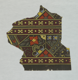 Small irregularly-shaped portion of a paper, probably a border, in a designof geometrical divisions set with flowers, in dark colors. Printed in red, black, yellow and green.