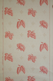 Four varieties of leaves forming diagonal rows, alternating with small upside down triangle with circle on top. Printed in salmon color on all-over spotted white ground.