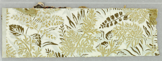 Aesthetic-style design; fern and other foliage printed in ocher, metallic gold and very pale green over deeper pale green.