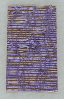 Woven with lavender grass and purple threads on a metallic copper ground.