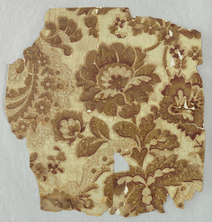Large stylized floral motif. Printed in brown, deep red and cream color on tan ground.