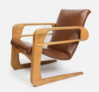 """C"" cantilever birch frame. Bent plywood seat upholstered with brown naugahyde."