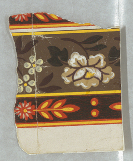 Small portion of paper, probably for a border, showing a band of flowers and leaves. Printed in yellows, orange, brown and black.