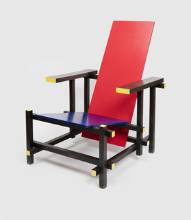 Rectangular chair with a raking long red back and blue seat,  rectangular section arms and legs are black painted yellow at the  ends,the arms at right angles to the uprights