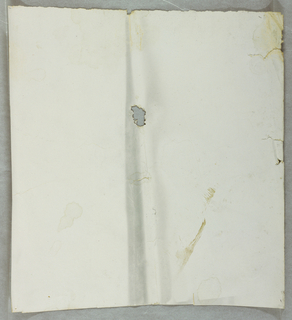 Unprinted off-white or taupe ground paper.  Very soiled, with dark streak across center. Small loss in middle of sample.