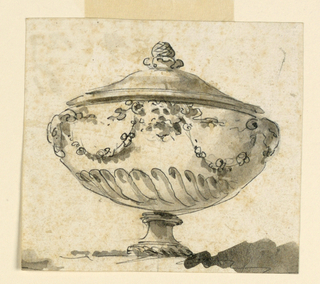 Wide footed urn decorated with spiraling gadrooning, masks and festoons.