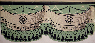 Simulates a festooned border draped in swags and caught up with poufs. At the top are festooned strings of beads. An Empire design in black is blocked over the center portion and black tasseled fringe is at the bottom. Used in restoration of Mme. Jumel's bedroom in the Jumel Mansion in New York City.