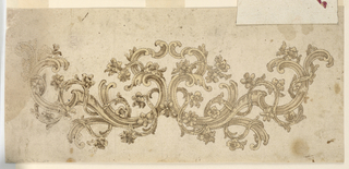 Volute scrolls, which are surrounded by waved stems with leaves and blossoms form a symmetric crest motif. Pricked.