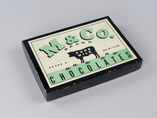"""Black blox with with lid white label: """"M&Co.Brand  Pure Milk Chocolates"""""""