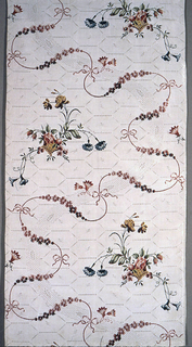 Length of woven silk, brocaded with an undulating pink ribbon forming an overall S-curve, interspersed with baskets of flowers, in red, rose, yellow-green, dark green, and blue, on a white ground woven with a monochrome honeycomb pattern.