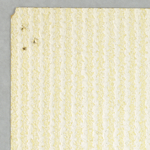 A ragged pattern of raised vertical stripes, printed in pale yellow and white.