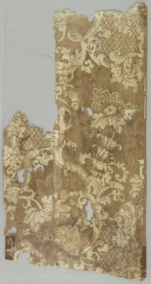 Rococo revival pattern with scrolling foliage and large flowers. Fills of trellis pattern. Printed in white on ungrounded paper. Many small pieces of the same design.