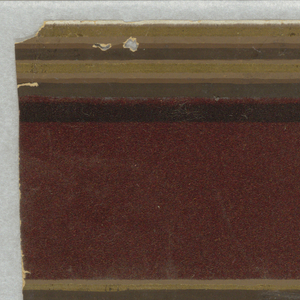 Brownish-red flock border with narrow bands of gold along top and bottom edges, similates architectural molding.
