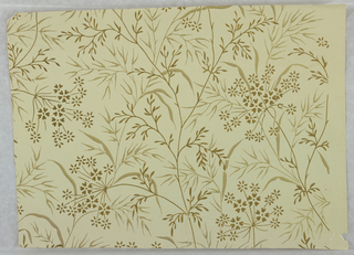 All-over pattern of flowers and foliage printed in light blue on blue ground, with gold stippling.