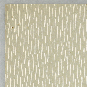 A textured pattern that resembles blades of grass. Printed in light gray brown and white.