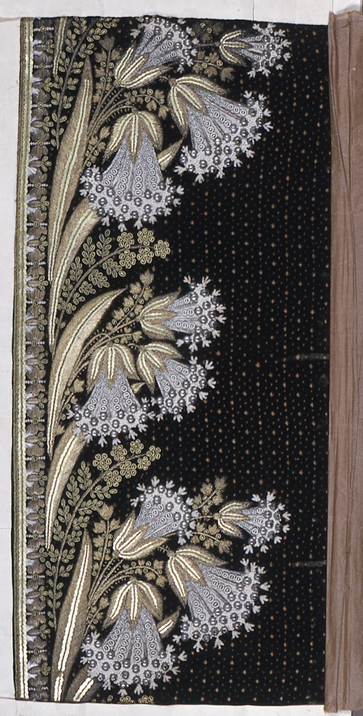 Dark green cut and voided velvet with minute dot pattern embroidered in elaborate border design of flower sprays in gold and silver with silver and white beads.