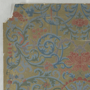 Delicately drawn but dense pattern of foliate scrolls and flowers on metallic gold ground.