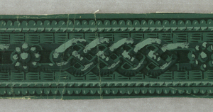 Against a field resembling weaving or basket work, horizontal groups of interlacings alternate with single rosettes. Running moldings at top and bottom. Pale green, dark green and black, on green ground.