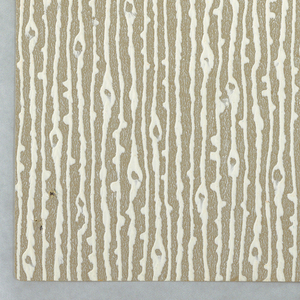 Raised pattern with vertical lines that simulate wood grain. Irregular, thick and thin lines simulating vertical wood grain texture. Printed in heavy pigment, giving an embossed effect.