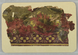 Aesthetic or Anglo-Japanesque design. Band of deep red flowers across center. Olive-green foliage above. Band of quatrefoils below. Printed in deep red, olive-green and tan on burgundy ground.