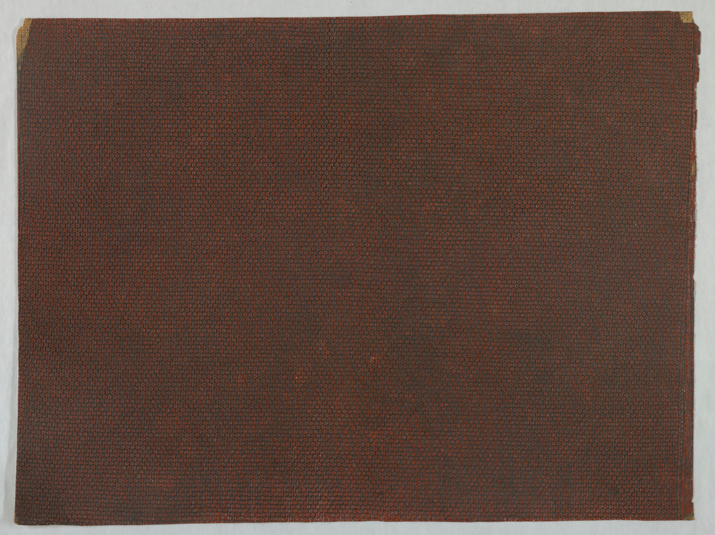 Rows of very small circles similar to lizard skin. Black ground over which brownish-red has been worked.