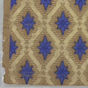 Full length of paper with lozenge-shaped diaper design. Cream framework enclosing eight-pointed blue figure, outlined in black. Printed in blue, white and black on ungrounded paper.