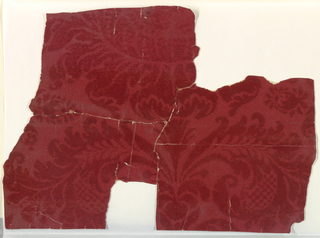 Red flock, damask-like pattern, with step-edged outlines.