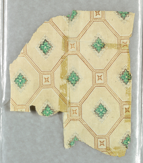 Green acanthus boss set within a diamond diaper design.