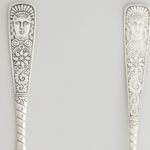 Decorative portrait handle knife with turned detail down to the carved blade with an ornamental serrated edge.