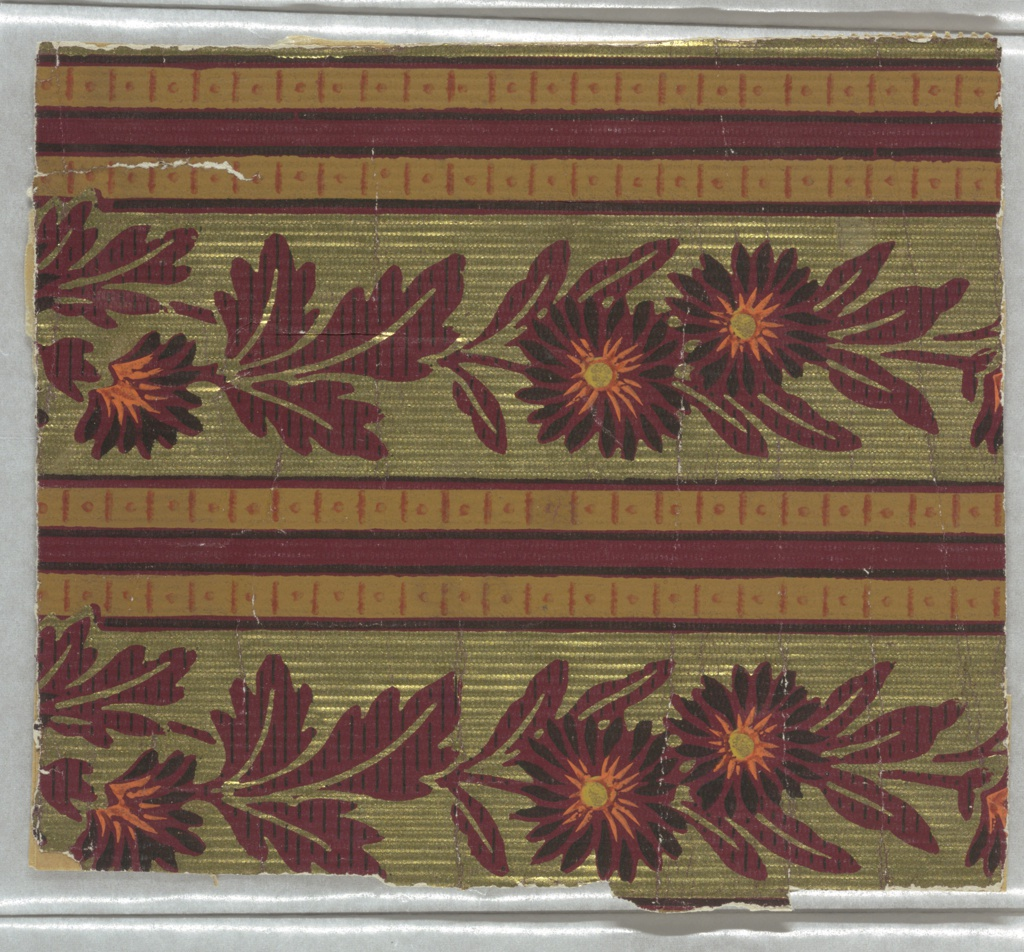 Aesthetic or Anglo-Japanesque printed two across the width. Floral stripe design with bands of deep red flowers alternating with a triple stripe. Printed on an embossed metallic gold ground.
